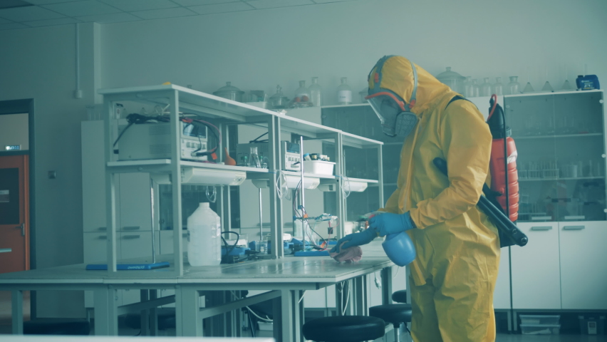 Disinfection expert is cleaning table in the laboratory Royalty-Free Stock Footage #1069489780