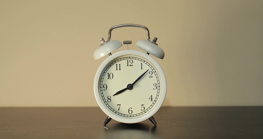 Setting clock forward by one hour for summer daylight saving time in the spring in March Royalty-Free Stock Footage #1069558684