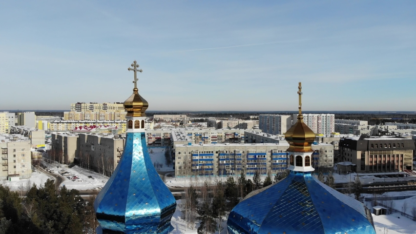 Aerial view of Surgut City Russia at sunny day, Church of the Icon of the Mother of God of Tenderness. Beautiful Surgut Skyline aerial view. Surgut skyline panoramic. Royalty-Free Stock Footage #1069580290