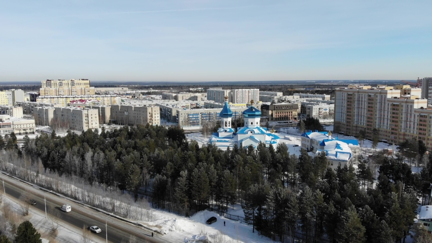 Aerial view of Surgut City Russia at sunny day, Church of the Icon of the Mother of God of Tenderness. Beautiful Surgut Skyline aerial view. Surgut skyline panoramic. Royalty-Free Stock Footage #1069582795
