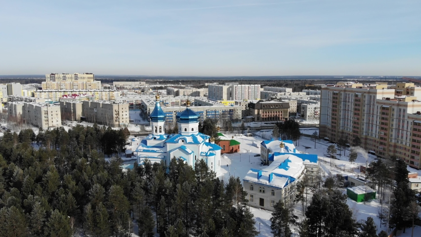Aerial view of Surgut City Russia at sunny day, Church of the Icon of the Mother of God of Tenderness. Beautiful Surgut Skyline aerial view. Surgut skyline panoramic. Royalty-Free Stock Footage #1069587244