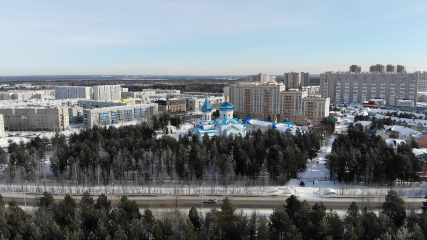 Aerial view of Surgut City Russia at sunny day, Church of the Icon of the Mother of God of Tenderness. Beautiful Surgut Skyline aerial view. Surgut skyline panoramic. Royalty-Free Stock Footage #1069590562