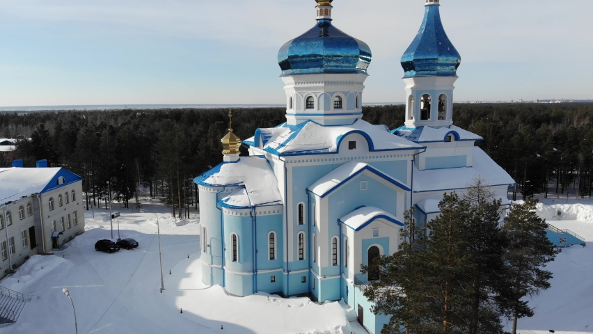 Aerial view of Surgut City Russia at sunny day, Church of the Icon of the Mother of God of Tenderness. Beautiful Surgut Skyline aerial view. Surgut skyline panoramic. Royalty-Free Stock Footage #1069592203