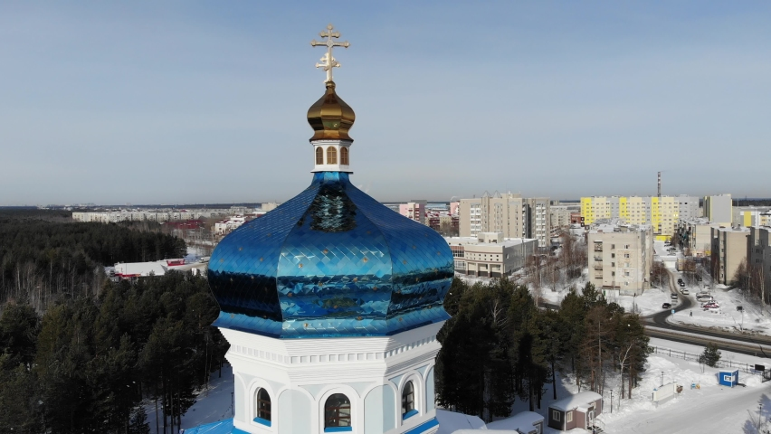 Aerial view of Surgut City Russia at sunny day, Church of the Icon of the Mother of God of Tenderness. Beautiful Surgut Skyline aerial view. Surgut skyline panoramic. Royalty-Free Stock Footage #1069595344