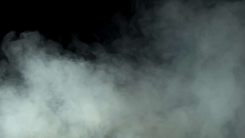 Realistic smoke clouds on a black background. | Shutterstock HD Video #1069615321