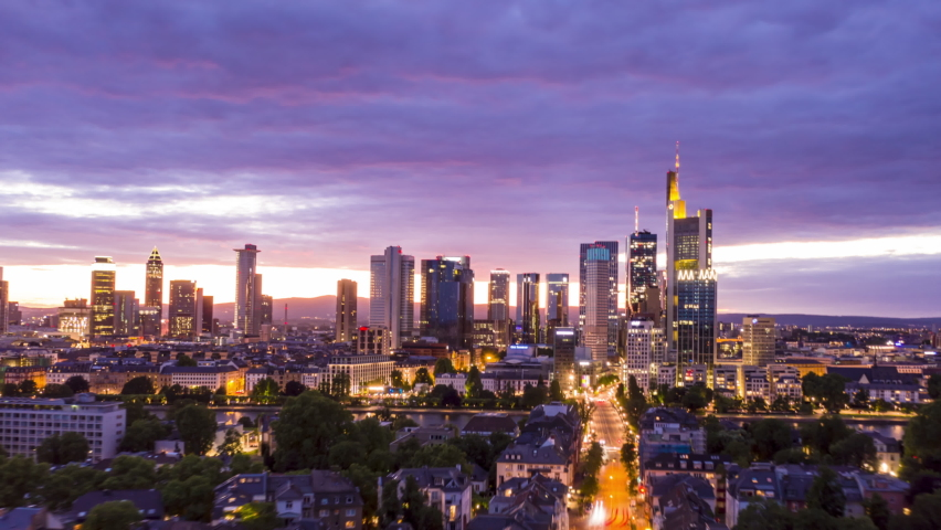 AERIAL: Night Hyper Lapse, Motion Time Lapse of Frankfurt am Main Germany Skyline view and beautiful city lights with Main River in foreground circa june 2020