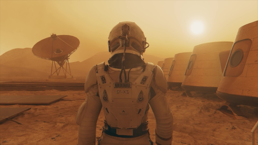 Astronaut on the planet Mars, making a detour around his base. Astronaut walking along the base. Small dust storm. The satellite dish sends data to the ground. Realistic 3D animation | Shutterstock HD Video #1069721089