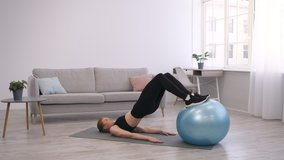 Female Workout. Fitness Woman Exercising With Swiss Ball Lying On Floor At Home. Domestic Training And Abs Exercises Concept. Slow Motion, Side View, Free Space For Text