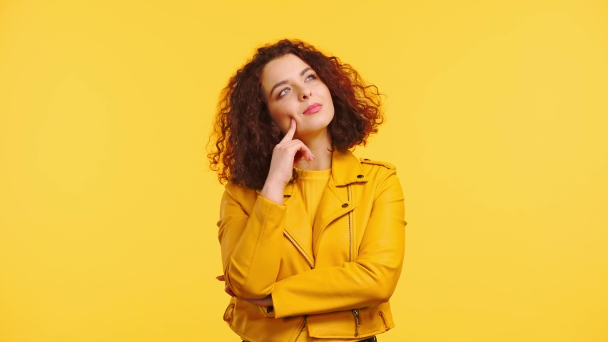 Thoughtful girl showing idea gesture, smiling and gesturing isolated on yellow | Shutterstock HD Video #1069762081
