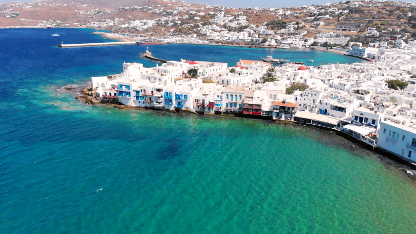 Aerial view of little Venice seafront neighborhood and old port of Mykonos island, Greece.   Shutterstock HD Video #1069794580