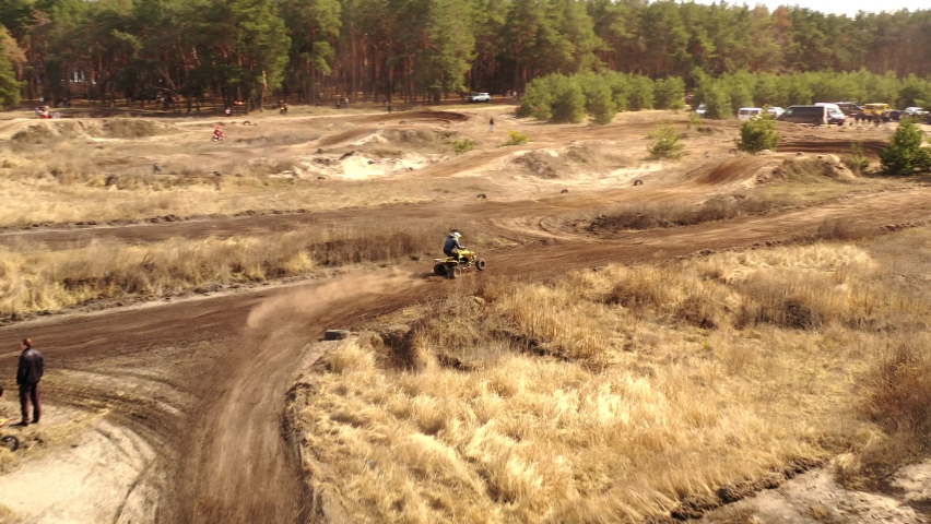 Motorcyclists on the motocross track, ride off-road and jump over sandy hills. drone video 4k | Shutterstock HD Video #1069803757