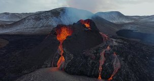 4K Drone aerial video of Iceland Volcanic eruption 2021. The volcano Fagradalsfjall is located in the valley Geldingadalir close to Grindavik and Reykjavik. Hot lava and magma coming out of the crater