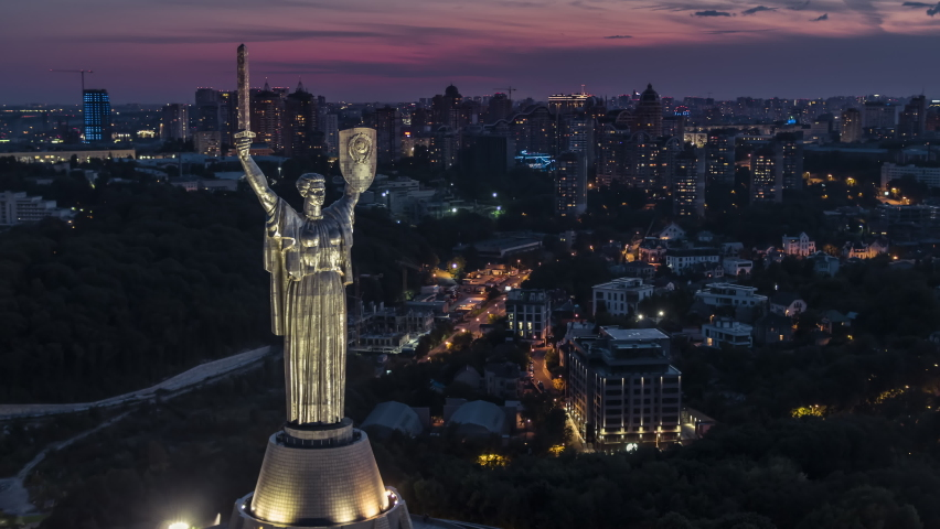 Kiev, Ukraine, circa 2019 - Establishing Aerial View Shot of Kyiv Kiev, glorious The Motherland Monument, Lesi Ukrainky Blvd, Ukraine at night evening