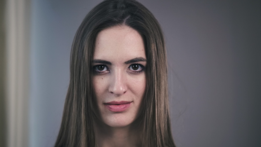 Confident Young Adult European Woman Looking At Camera Millennial Casual Professional Lady With Pretty Face Posing For Close Up Portrait Indoors