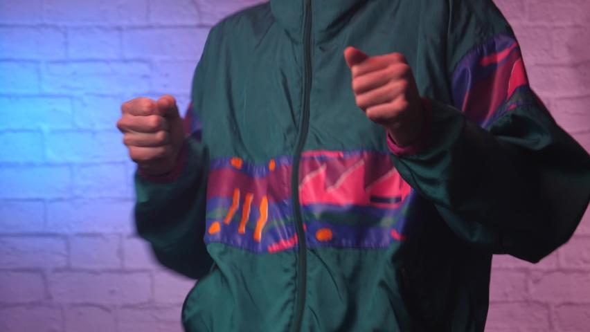 Dancing retro 80s 90s man having fun. 80s 90s 1980 1990 era style. | Shutterstock HD Video #1070036929