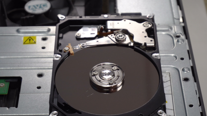4K Close up of a hard disk drive reading and writing data and internal structure for computer PC or Server and Cloud technology.   Shutterstock HD Video #1070069707