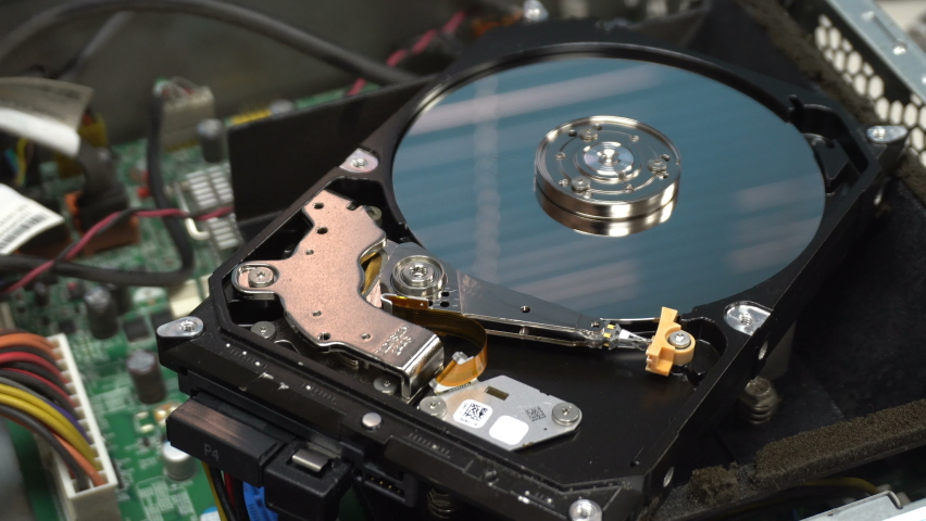 4K Close up of a hard disk drive reading and writing data and internal structure for computer PC or Server and Cloud technology.   Shutterstock HD Video #1070069710