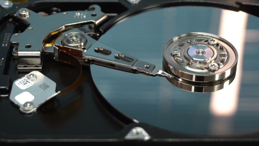4K Close up of a hard disk drive reading and writing data and internal structure for computer PC or Server and Cloud technology.   Shutterstock HD Video #1070069713