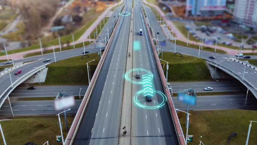 Autonomous Self Driving Cars Moving Through City Highway. Speed and identity Control System. Future transportation. Artificial Intelligence Digitalizes and Analyzes Road. Shot from drone. | Shutterstock HD Video #1070161390