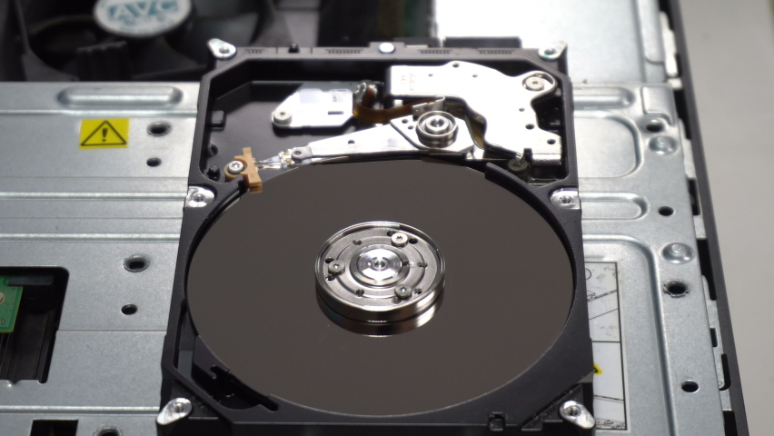 4K Close up of a hard disk drive reading and writing data and internal structure for computer PC or Server and Cloud technology.   Shutterstock HD Video #1070161831