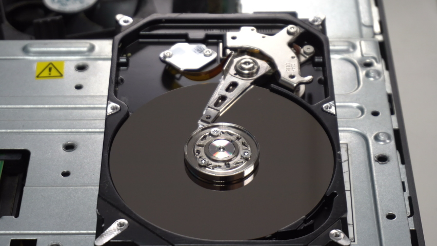 4K Close up of a hard disk drive reading and writing data and internal structure for computer PC or Server and Cloud technology.   Shutterstock HD Video #1070262181