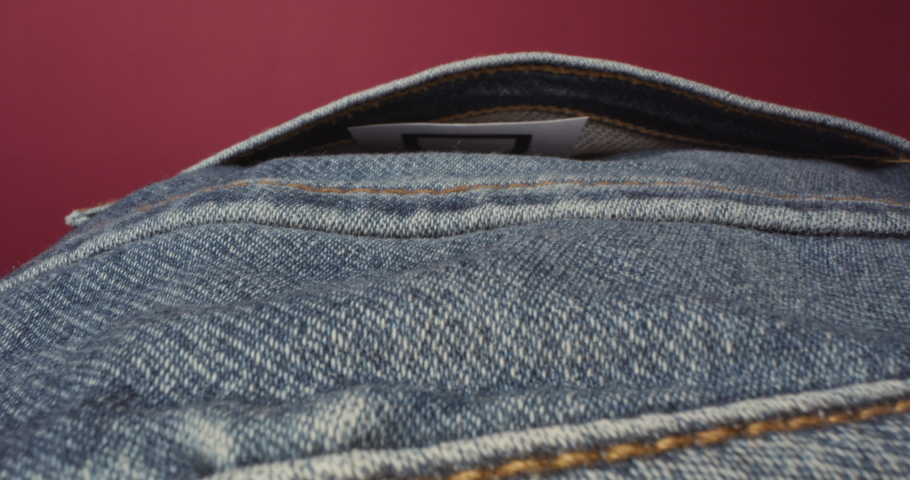 Man removes Debt from jeans pocket instead of money. Student loans or abstract. High quality 4k footage