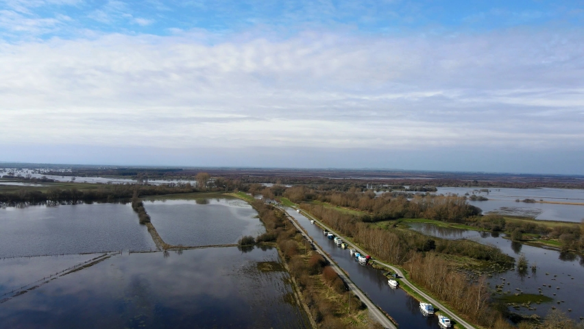 Shannon Harbour, County Offaly, Ireland. Aerial view over the Grand Canal and overflowed Shannon River. A vast aria of farmland got flooded after river burst its banks in the aftermath of heavy rain. Royalty-Free Stock Footage #1070356132