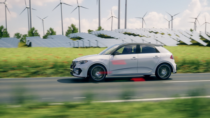 Generic electric car driving through green landscape with solar panels and wind turbines in background. Realistic 3d animation. Generic car and logo design, no intellectual property infringement. Royalty-Free Stock Footage #1070360173