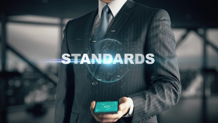 Businessman with Standards hologram concept Royalty-Free Stock Footage #1070360731