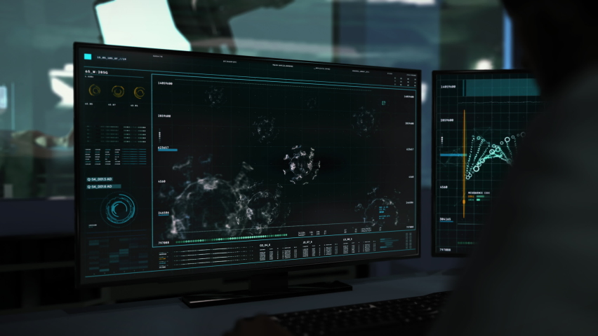 Computer Screens. The Doctor is Sitting Behind the Desk. Medical Research Software. Deep Structures of the Newest Virus Stamm are Analyzed. Signs of Coronavirus were Found. Data Analysis. | Shutterstock HD Video #1070361370