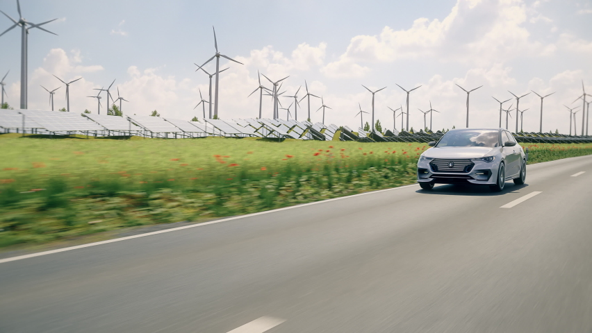 Generic electric car driving through green landscape with solar panels and wind turbines in background. Realistic 3d animation. Generic car and logo design, no intellectual property infringement. Royalty-Free Stock Footage #1070375476
