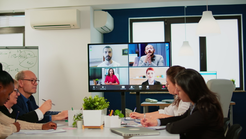 Headshot screen application view of remote multiracial employees talking on video call brainstorm together multiethnic coworkers engaged in team discussion online using web conference, virtual meeting Royalty-Free Stock Footage #1070388682