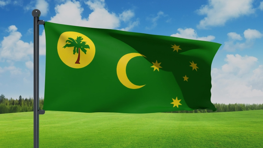 3D illustration of Waving flag of Cocos (Keeling) Islands with chrome flag pole in grass cloudy background waving in the wind. High resolution flag with clarity natural background.