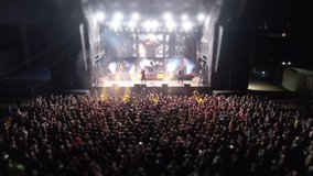Tilt-shift effect Drone from the the crowd. Night concert. Top down view of the crowd