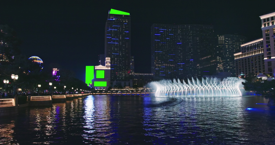 Modern skyscraper buildings with green screens for business commercial. Night scene Las Vegas downtown, The Strip night life with clubs, casinos and adult entertainments. Urban illumination footage 4K | Shutterstock HD Video #1070511223