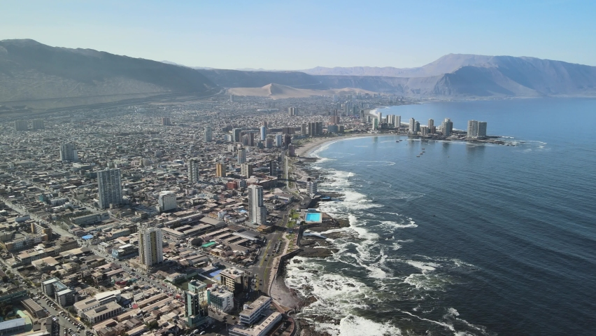 Iquique Chile. Drone aerial view, modern coastal city waterfront, buildings and Pacific ocean waves on sunny day | Shutterstock HD Video #1070534782