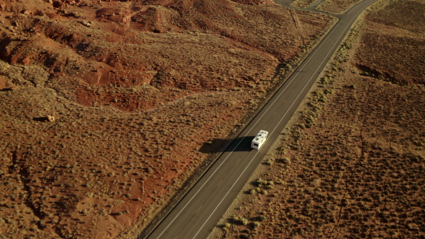RV driving along road on American road trip with beautiful smooth drone footage