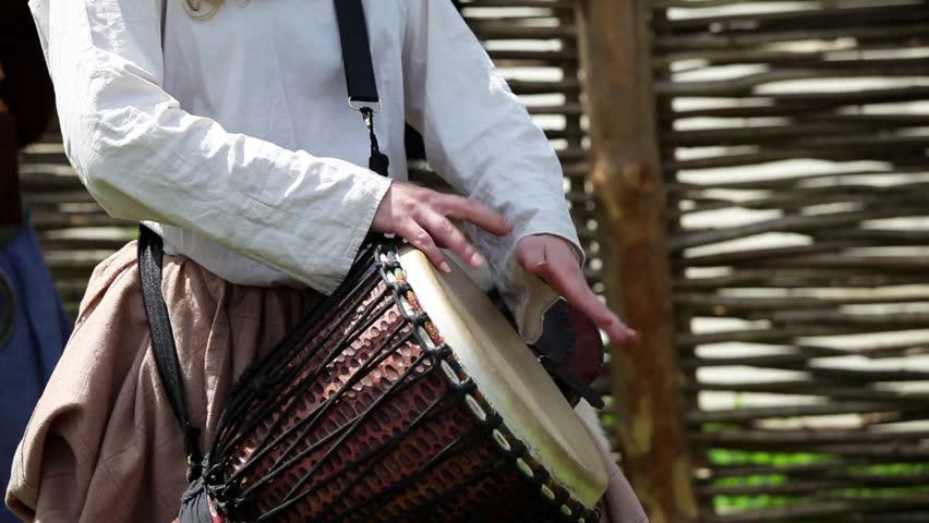 Girl playing on djembe drum   Shutterstock HD Video #10706636