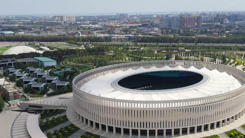 Krasnodar, Russia - August 29, 2020: Krasnodar - football stadium of the eponymous club in the city of Krasnodar. Public Park Krasnodar (Galitsky Park). Summer aerial view, Aerial View, Point of inte