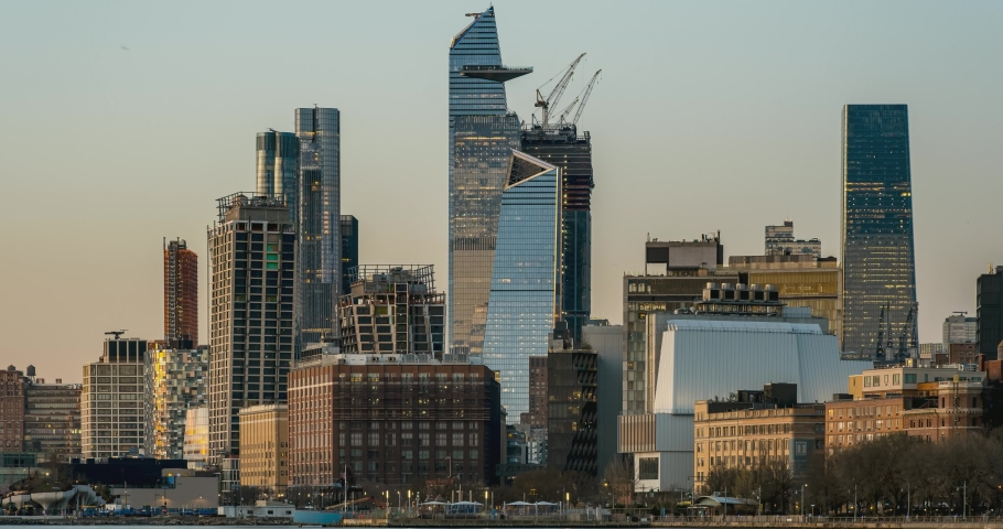 New York City - USA - Apr 7 2021: Day to Night Timelapse Sunset Clouds Moving Over Hudson Yards POV view from Hudson River Park Greenwich Village | Shutterstock HD Video #1070694088