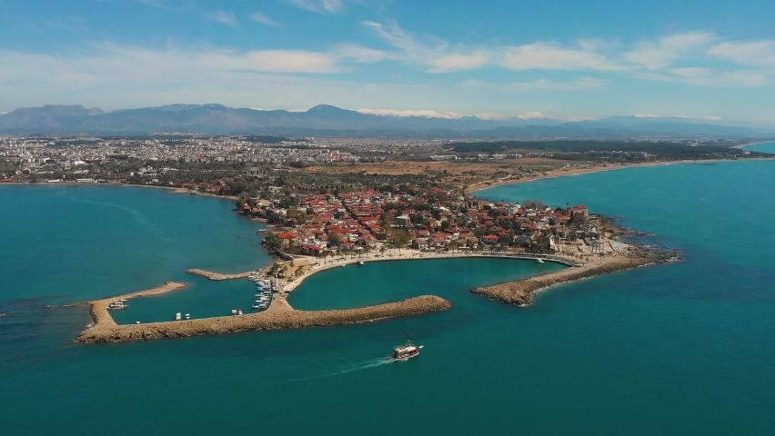 Drone aerial wiew of Side city and harbour in Antalya Turkey. Ruins of Apollon Temple in Side Ancient City. Top view in  beautiful summer day. | Shutterstock HD Video #1070710873