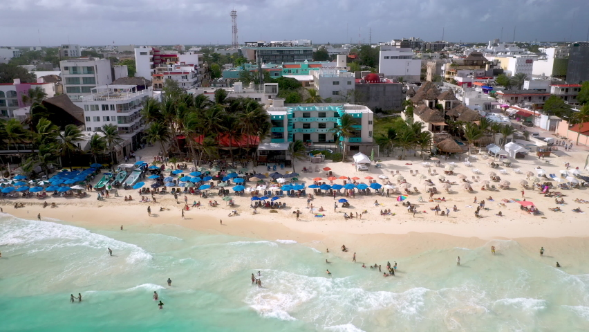 Revealing drone shot of people on the beach and the beach resorts at Playa Del Carmen Mexico | Shutterstock HD Video #1070754745