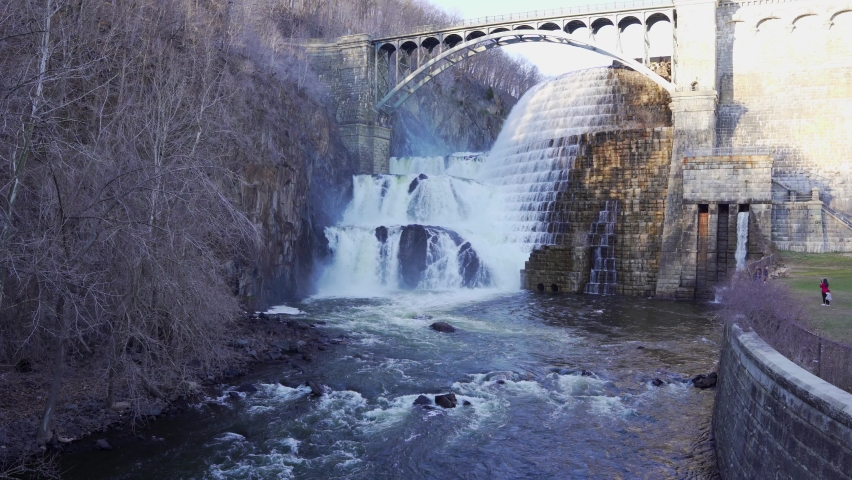 People at waterfall of New Croton dam in Westchester County, New York. Aerial static shot   Shutterstock HD Video #1070756758