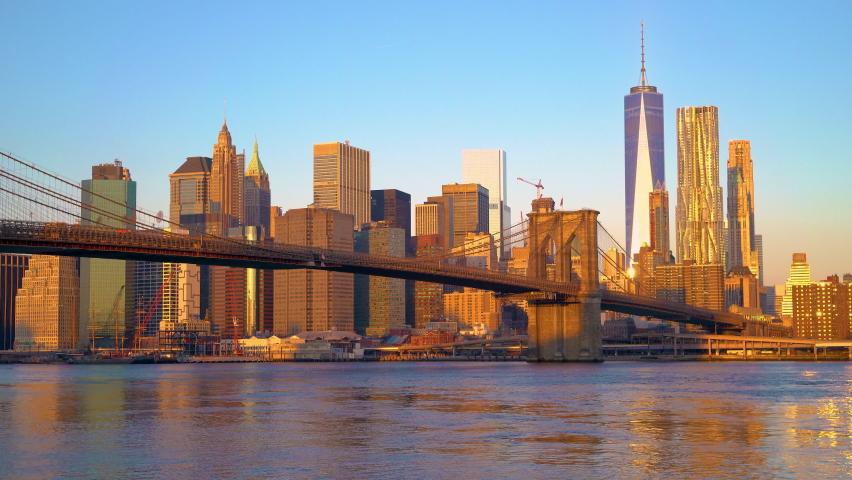 Panoramic view of Brooklyn bridge and Manhattan at sunrise, New York City.   Shutterstock HD Video #1070773615