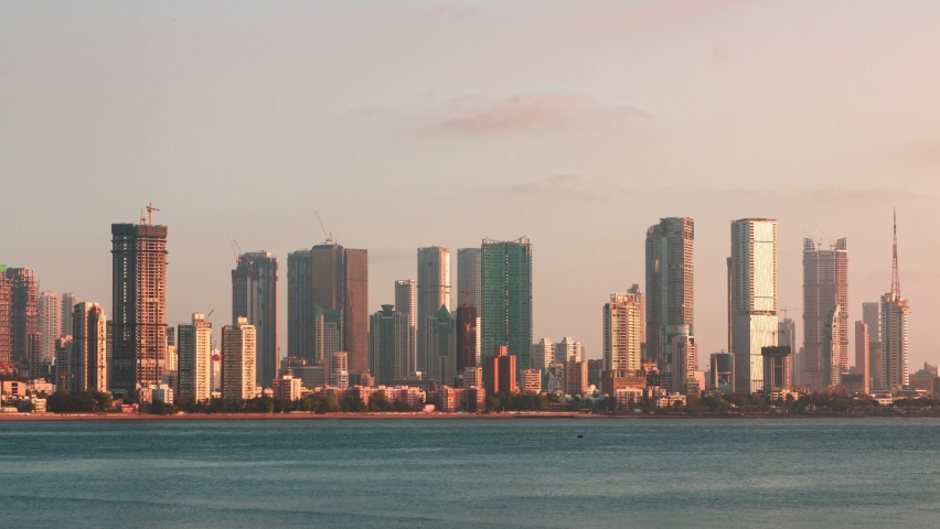 4K Logo Free Left to Right Panning Day Timelapse of Mumbai City Skyline taken from Bandra Reclamation Promenade during a colorful cloudy sunset on a summer evening. Mumbai, Maharashtra, India.   Shutterstock HD Video #1070785153