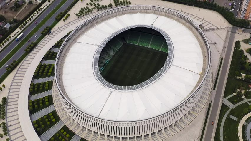 Krasnodar, Russia - August 28, 2020: Krasnodar - football stadium of the eponymous club in the city of Krasnodar. Public Park Krasnodar (Galitsky Park). Summer aerial view, Aerial View, Departure of