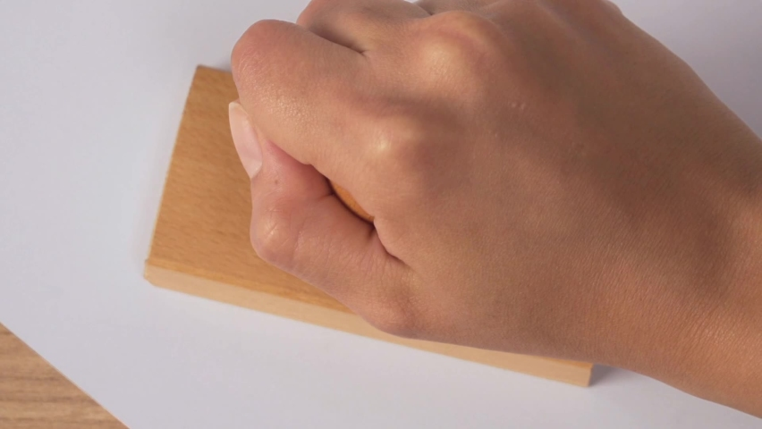Close up hand putting stamp failed on paper concept bureaucracy | Shutterstock HD Video #1070790520