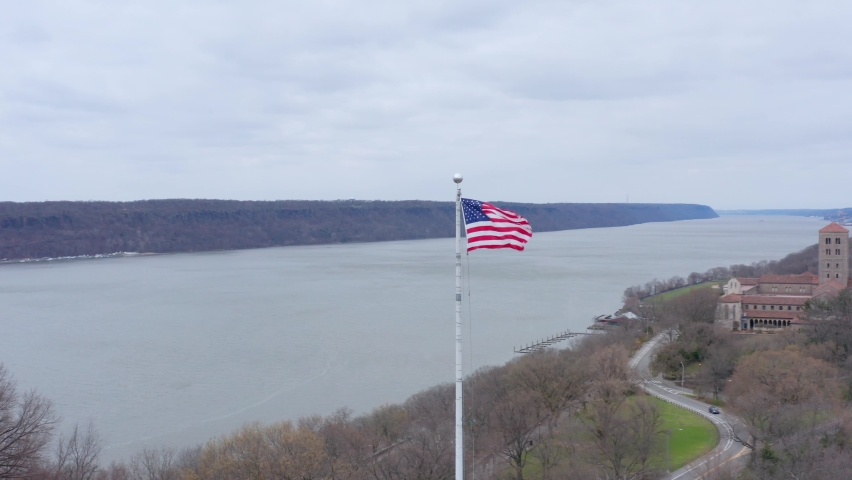 American flag waving in the wind near Hudson river, New York. Aerial circling | Shutterstock HD Video #1070791243