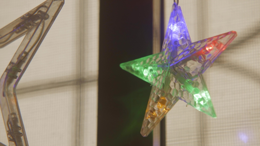 Merry Xmas star led light hanging in window colourful two | Shutterstock HD Video #1070791351