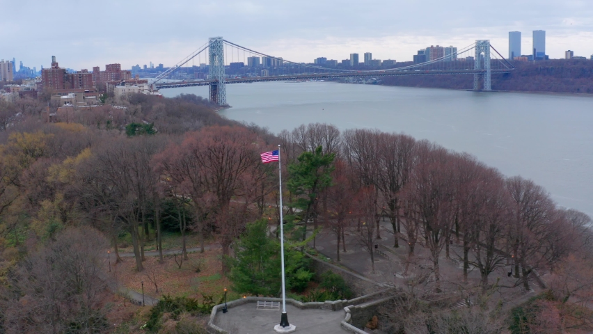 American flag with George Washington Bridge in background. Aerial circling | Shutterstock HD Video #1070791498
